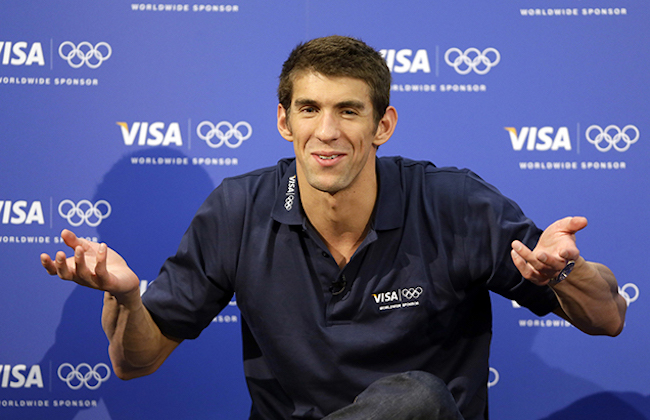 United States swimmer Michael Phelps speaks during a news conference at the 2012 Summer Olympics, London, Sunday, Aug. 5, 2012. (AP Photo/Kirsty Wigglesworth)