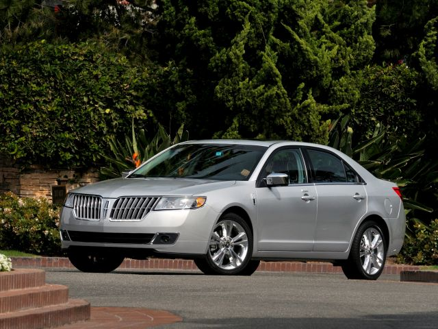 2010 Lincoln MKZ: The distinctive Lincoln style is readily apparent in the 2010 Lincoln MKZ. A split-wing grille flanks the distinctive Lincoln star and foreshadows heightened levels of luxury, comfort and styling found on the 2010 model.